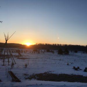 sunrise over snowy landscape